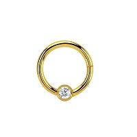 Nordik Piercing: Studio de piercing dans le 76: anneau doré à charnière avec cristal