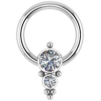 Nordik Piercing: Studio de piercing dans le 76: anneau titane smiley strass